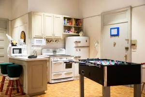 A kitchen or kitchenette at The Ultimate Sleepover at The FRIENDS Experience