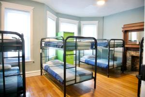 A bunk bed or bunk beds in a room at Wrigley Hostel - Chicago