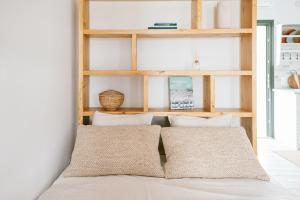 A bed or beds in a room at SilvAir II by Silvernoses, Mykonos