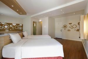Cama ou camas em um quarto em Mercure Sao Paulo Alamedas