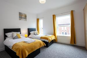 A bed or beds in a room at Inspired Stays ***City Centre Location***