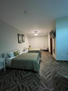 A bed or beds in a room at Hotel Monarca