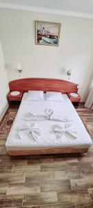 Кровать или кровати в номере Отель Paradise