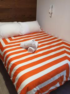 A bed or beds in a room at Byron Bay YHA