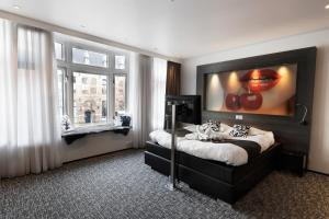 A bed or beds in a room at Apart! Food & Drinks Apartments