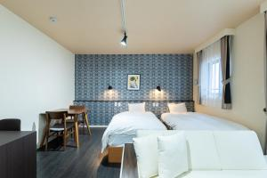 A bed or beds in a room at VACATION INN HEIWAJIMA I