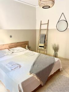 A bed or beds in a room at Bocca house near Athens Airport