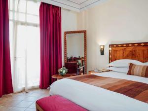 Un ou plusieurs lits dans un hébergement de l'établissement Hotel Le Médina Essaouira Thalassa sea & spa – Mgallery
