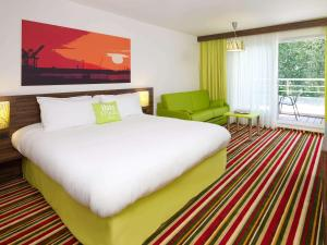 A bed or beds in a room at ibis Styles Zeebrugge