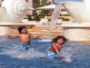 The swimming pool at or near Mövenpick Resort & Spa Tala Bay Aqaba
