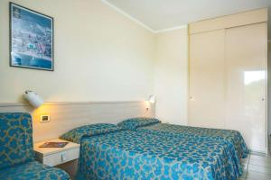 A bed or beds in a room at Hotel Fabricia