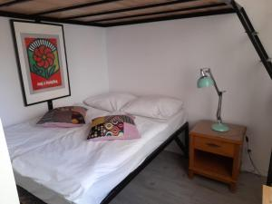 A bed or beds in a room at Old Town Kanonia Hostel & Apartments