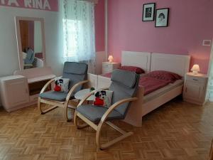 A seating area at Apartments Rupnik