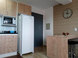 A kitchen or kitchenette at Loft Las Piedras
