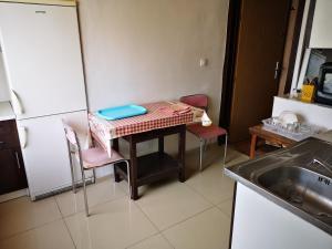 A kitchen or kitchenette at Byt pre 8 ľudí