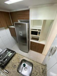 A kitchen or kitchenette at Brisa do Mar Apartments