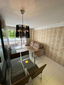 A seating area at Brisa do Mar Apartments