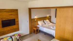 Cama ou camas em um quarto em Pousada Ilha Vitoria