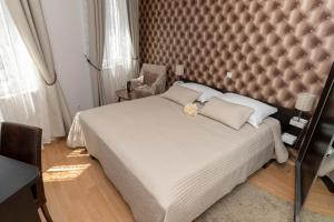 A bed or beds in a room at Deluxe Collection Hotel Kastel