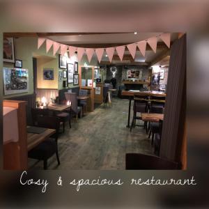 Restaurant o un lloc per menjar a The Drymen Inn