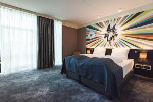 En eller flere senge i et værelse på Hotel Brandan