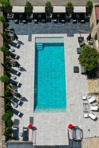 A view of the pool at Hôtel L'Abbaye or nearby