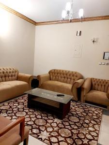 Uma área de estar em Hilion Hotel Apartments