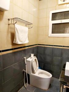 Um banheiro em Hilion Hotel Apartments