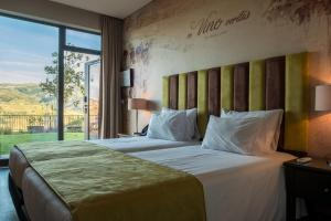 A bed or beds in a room at Vila Gale Douro Vineyards