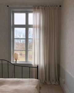 Säng eller sängar i ett rum på Hoby Kulle Herrgård B&B