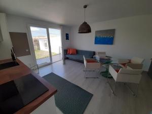 A seating area at VILLA MARETA BEACH II
