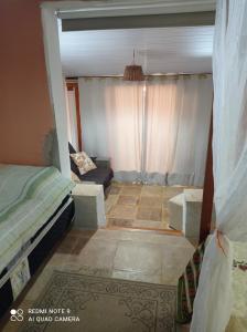 A bed or beds in a room at Pousada Yuste Beach Farm