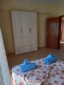 A bed or beds in a room at Apartments Skrapalli