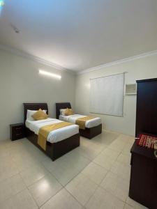 Cama ou camas em um quarto em الديوان للوحدات السكنية
