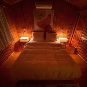 Кровать или кровати в номере Kibala Hotel