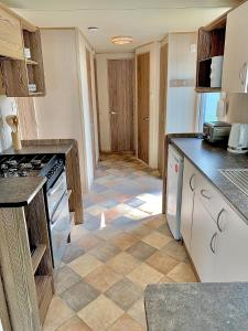 A kitchen or kitchenette at 3 Bed 8 Berth Caravan at Lakeside Thorpe Park