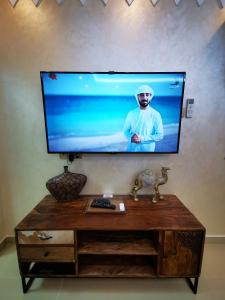 A television and/or entertainment center at ALBERI LODGE
