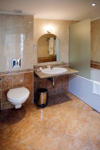 Een badkamer bij Sunset Resort