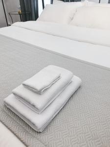 Кровать или кровати в номере Boutique Hotel Khovansky