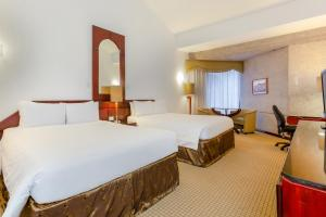 A bed or beds in a room at Radisson Hotel San Jose - Costa Rica