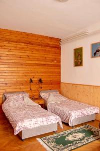 En eller flere senge i et værelse på Hajdu Lovasudvar Hortobágy
