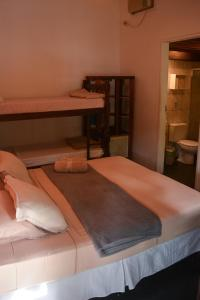 A bed or beds in a room at Pousada Paloma