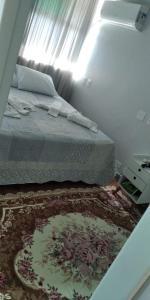 Cama ou camas em um quarto em Apartamento confortável