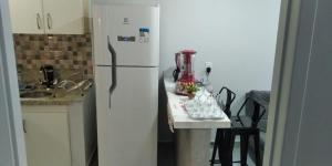 A cozinha ou cozinha compacta de Apartamento confortável