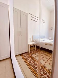 A bed or beds in a room at Liolà B&B