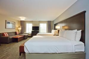 A bed or beds in a room at Staybridge Suites Austin South Interstate Hwy 35, an IHG Hotel