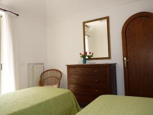 Letto o letti in una camera di Casa Fortunata