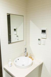 A bathroom at GLOU Higashi Shinjuku