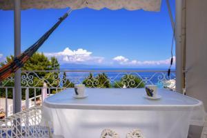 A balcony or terrace at Villa Baronnos by Konnect, Paxos island