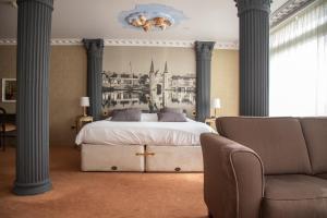 Een bed of bedden in een kamer bij Amicitia Hotel Sneek